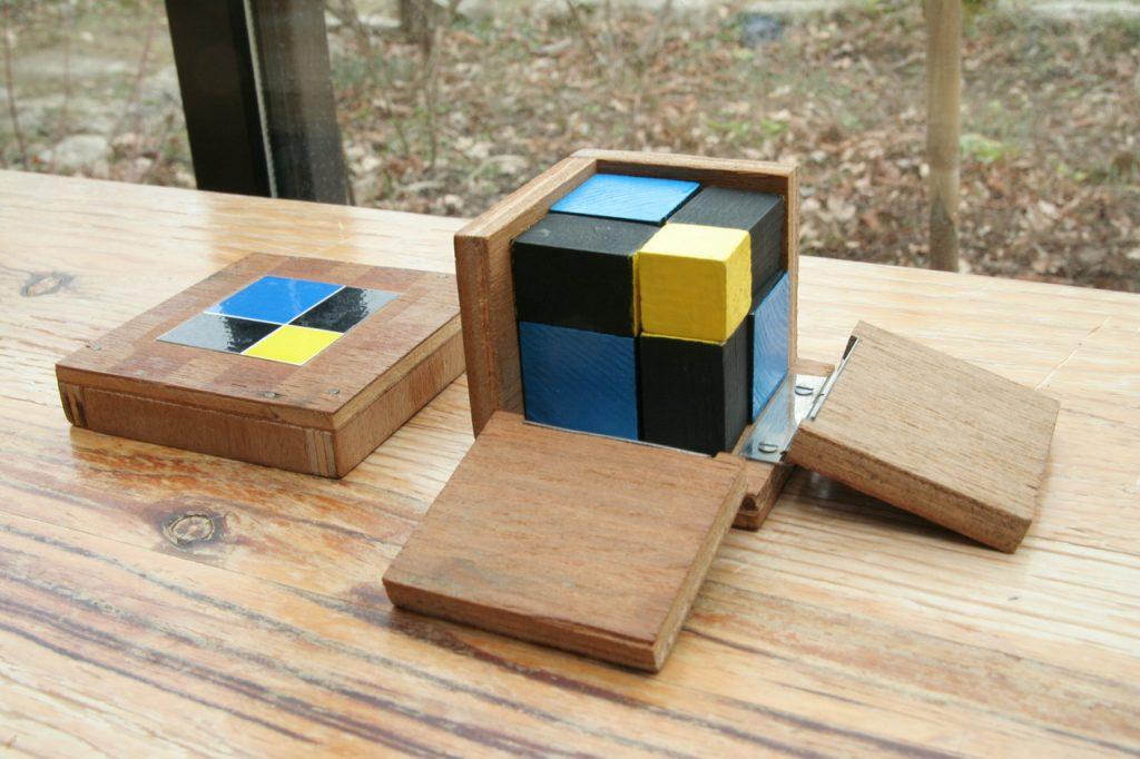 cube du binome jaune bleu